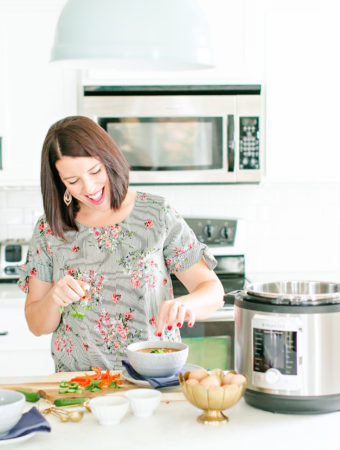 white kitchen with Jennie cooking instant pot