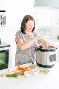 Woman cooking with instant pot ultra