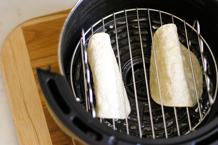 Air Fryer Taco Shells on rack in Air Fryer