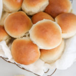 homemade rolls in a wire basket