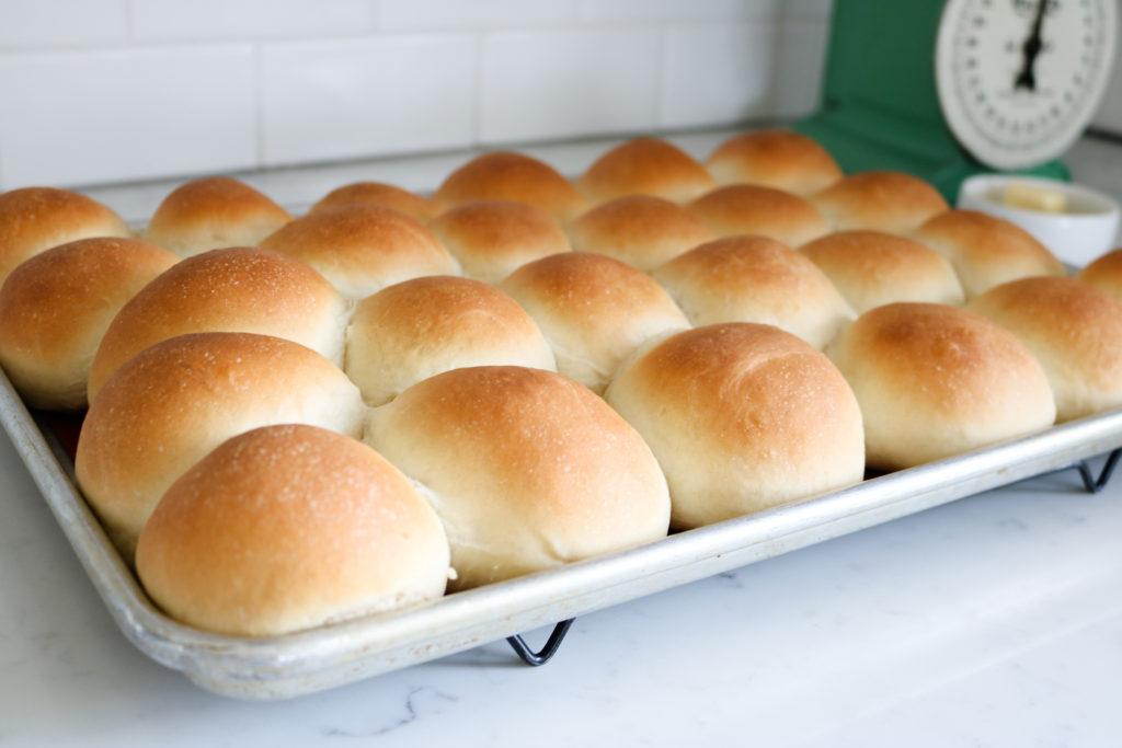 Fresh homemade rolls on a baking sheet