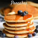 Gluten Free Pancakes from Bob's Redmill pancake mix with blueberries and syrup pouring on top with text overlay
