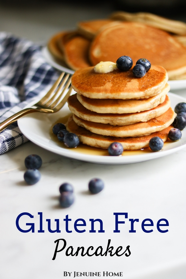 Gluten Free Pancakes from Bob's Redmill pancake mix with blueberries, butter and syrup on top with fork and napkin and text overlay