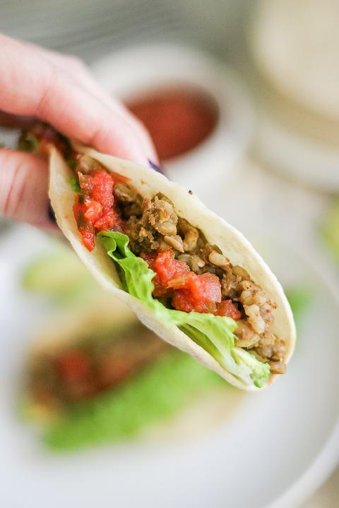 Hand holding Instant Pot Lentil Tacos