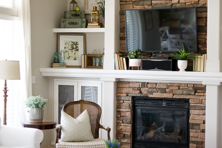 French country decor on built-in shelving with fireplace