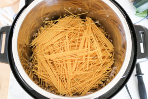 Spaghetti noodles layered in Instant Pot
