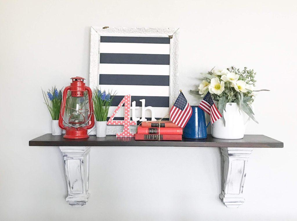 4th of July decor on shelf.