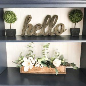 navy blue bookshelf with plants