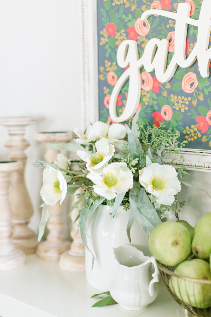 Flowers, candlesticks and pears