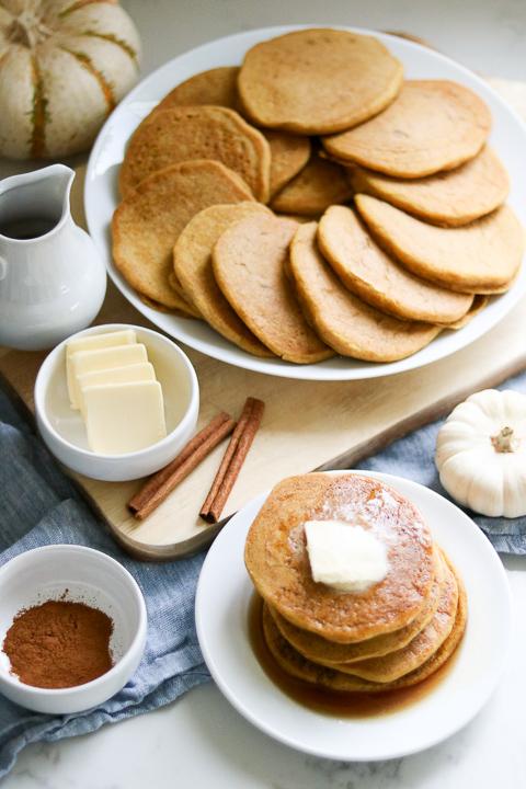 Plate full of gluten free pumpkin pancakes with butter