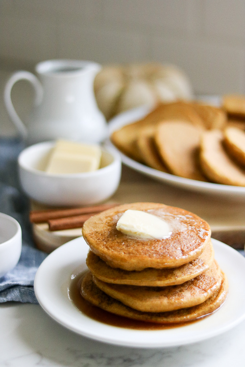 Stack of gluten free pumpkin pancakes with butter