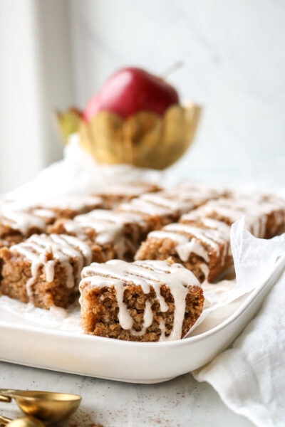 Gluten free applesauce bars with pumpkin spice glaze on a dish