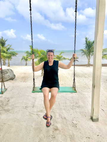 woman on swing on the beach