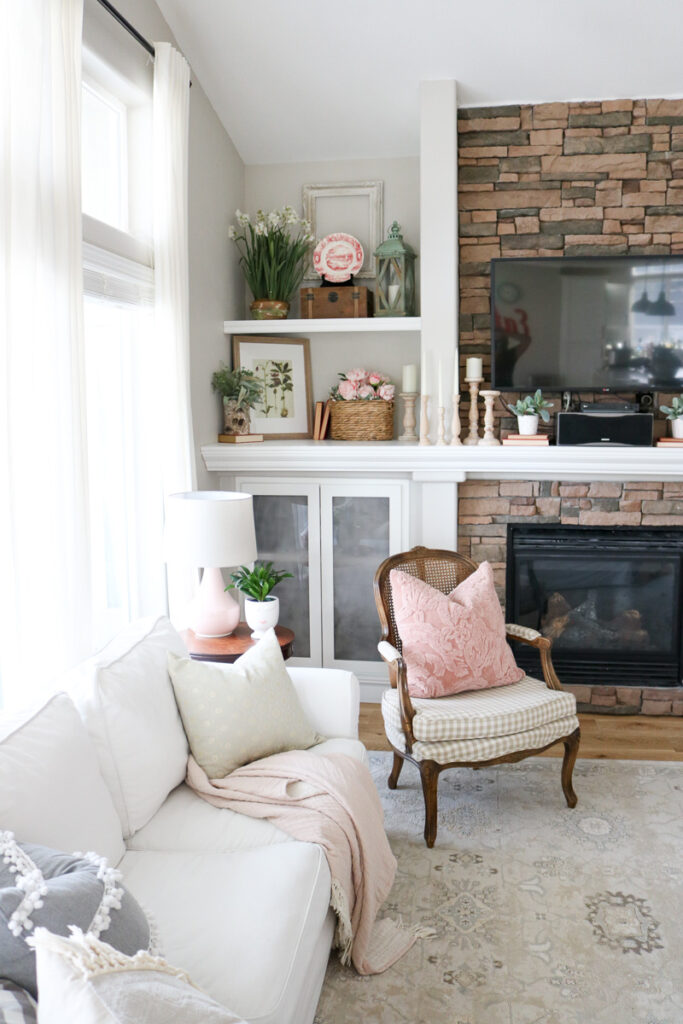 Fireplace mantle with pink accent decor