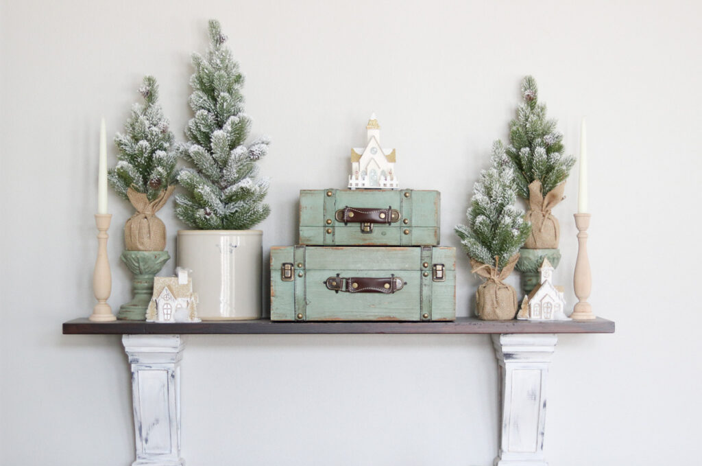 Shelf with winter decor and trees