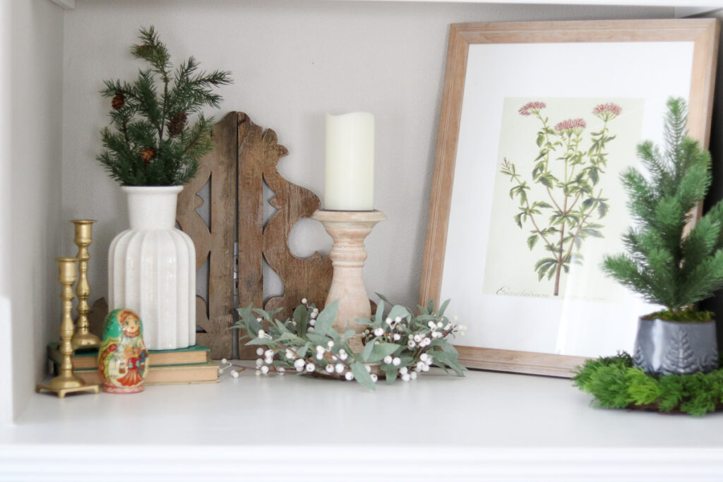 Candle stick, frame and fake plants
