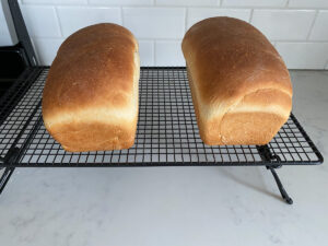 Bread loaves on cooling rack