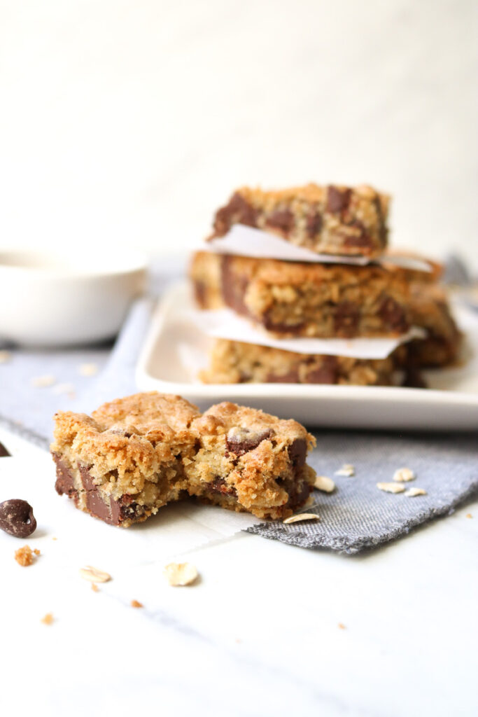 oatmeal chocolate chip cookie bars with bite taken