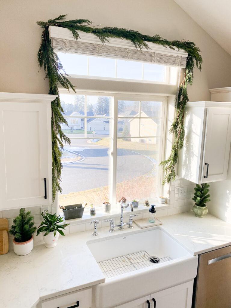 christmas garland around window and sink in kitchen
