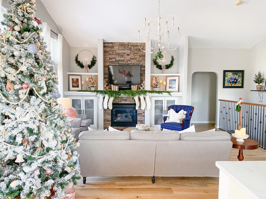 christmas decor in living room with couches and chair