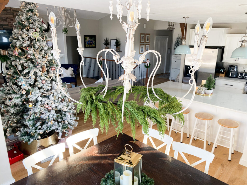 christmas garland on dining room chandelier