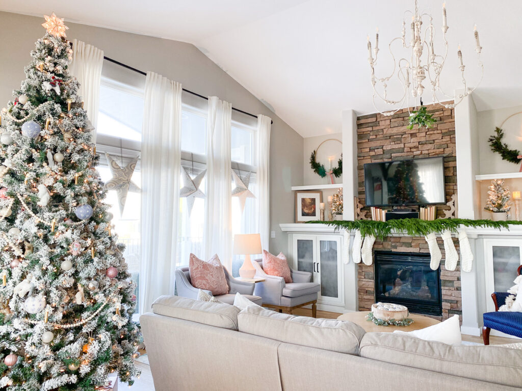 christmas decor on builtin shelving with fireplace