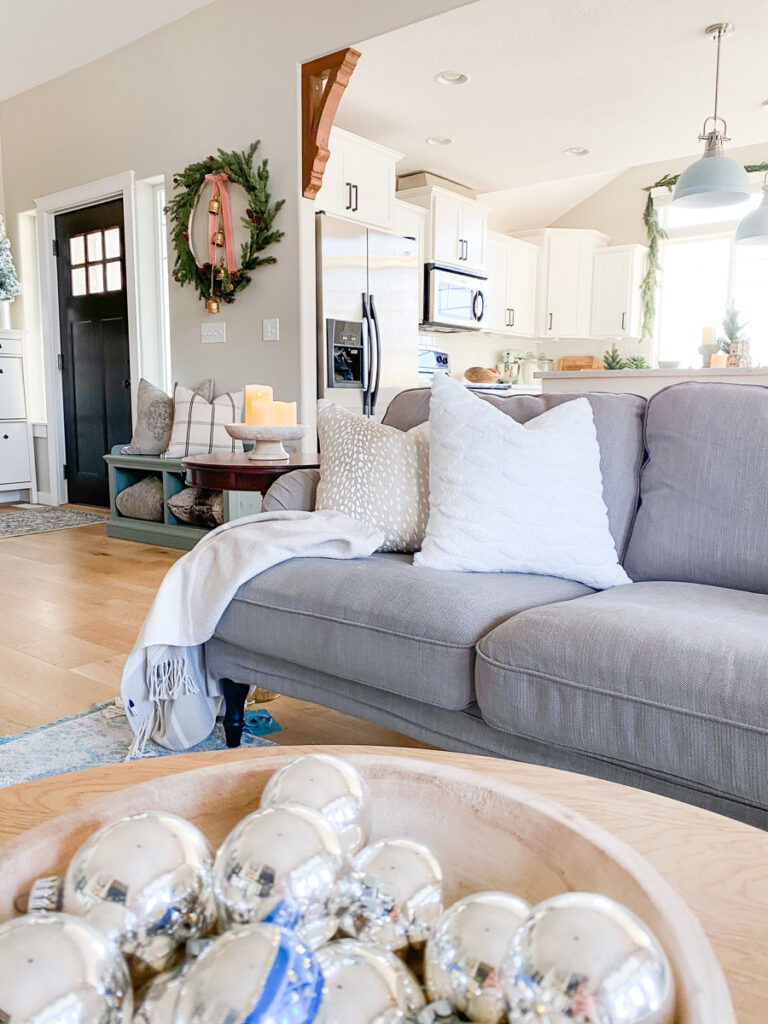 couch with throwpillows and christmas decor