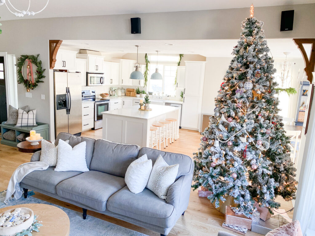 christmas living room decor with kitchen in background