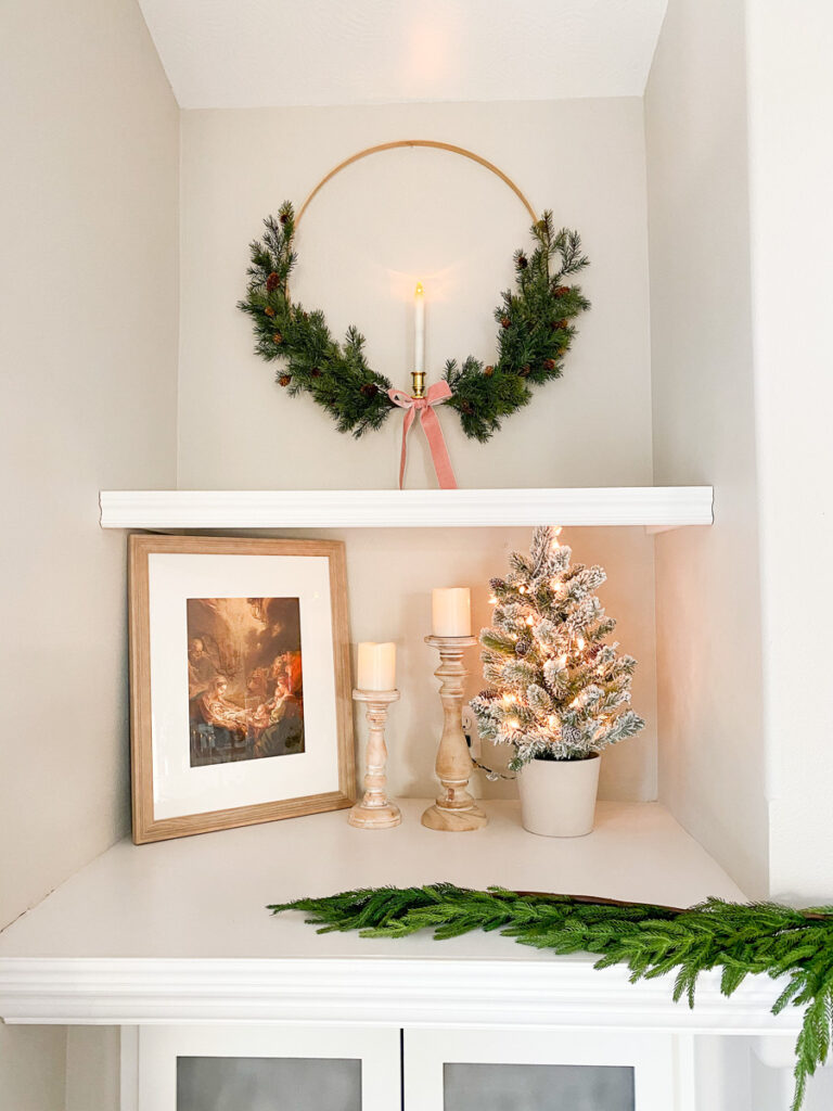 nativity image in frame with candles