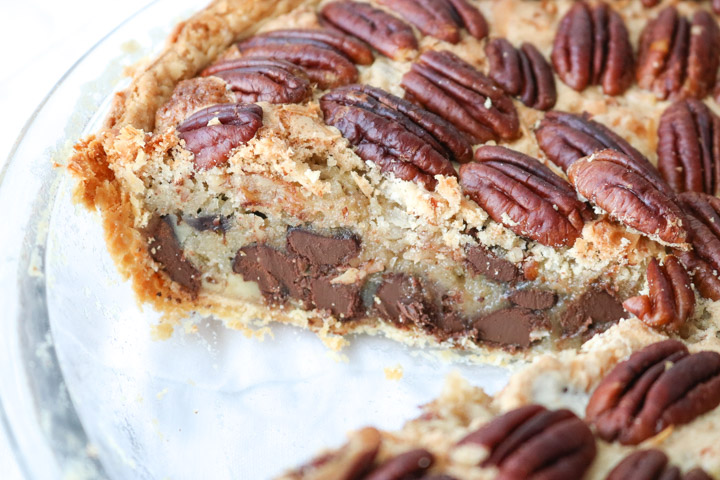 chocolate pecan pie with a slice removed to see the layers