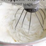mixer mixing heavy whipping cream stiff peaks with text overlay