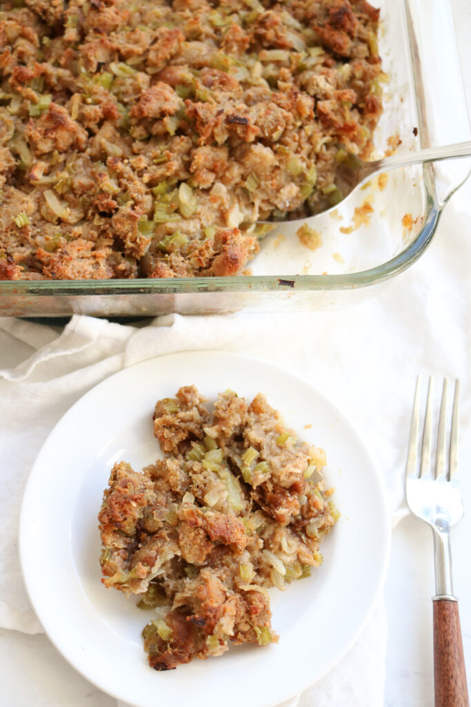 casserole dish with stuffing and white plate and fork