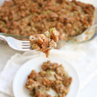 stuffing on a white plate with a forkful bite